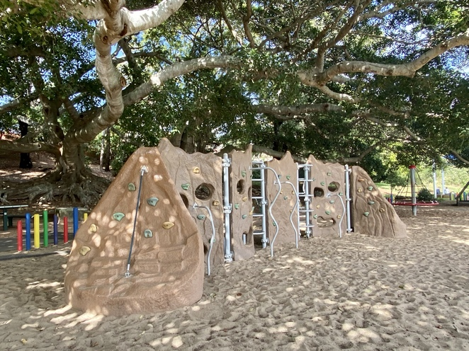 This shaded climbing wall is one of the playground's top attractions