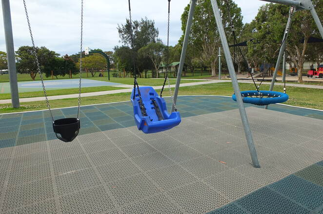 Grahame Stewart Park, Currimundi, fully fenced, off-street parking, child's paradise, Pioneer Park, Landsborough, stationary train, swings, circular rope activities, inclusive, all levels of ability, Where is the Green Sheep story seat, 10 Seats, 10 Stories, 10 Parks, multi-purpose court, flying fox, bike education track, miniature street signage, birthday parties, get-togethers, picnic, BBQ's, water fountains, toilet block, climbing frames, high-back disability swing, basketball court, cricket pitch, garbage bins, train driver, mountain climber, police officer, themed playground equipment, Currimundi Lake and Surf Beach