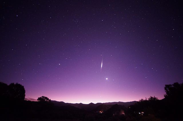 Photograph of a Leonid Meteor and predawn light courtesy of Mike Lewinksi at Flickr