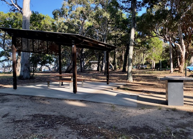 A picnic shelter and BBQ at Pioneer Park