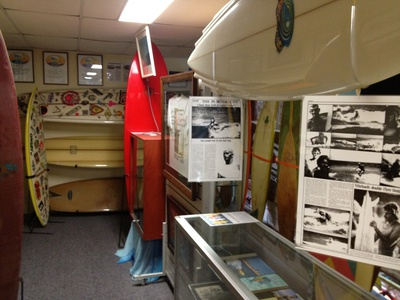The museum has pictures, posters, surfboards, torphies, videos and even trading cards