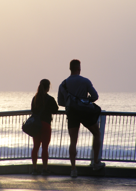 A couple preparing to jump in the ocean for a swim