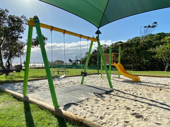 The multi-age swings are set over soft-fall surface