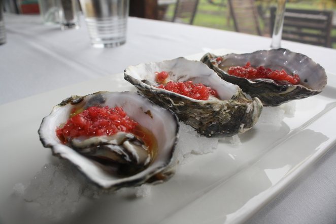 Large Coffin Bay oysters with lime caviar, strawberry salsa & crispy salt cured chilli - Photo Jenny Esots