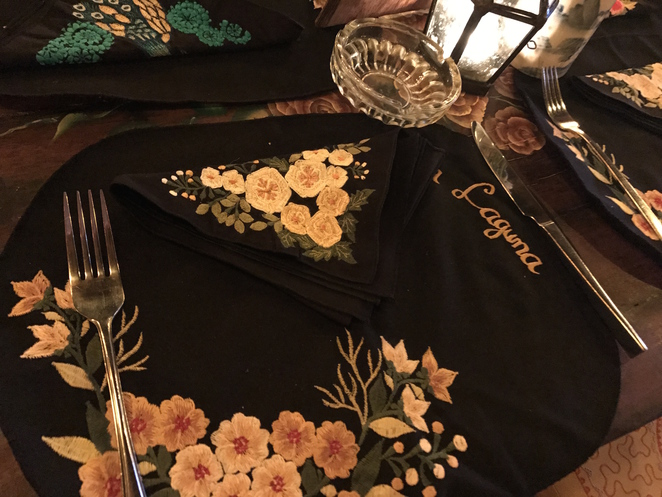 painted surfaces and embroidered tablecloths