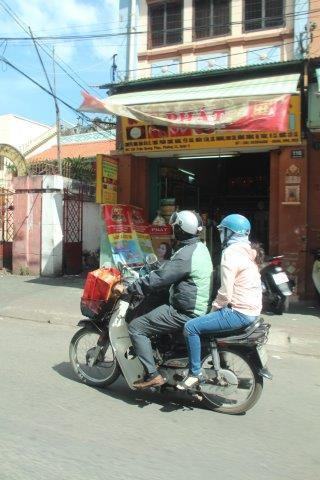 Ho Chi Minh City, Motorbike riders are fully covered