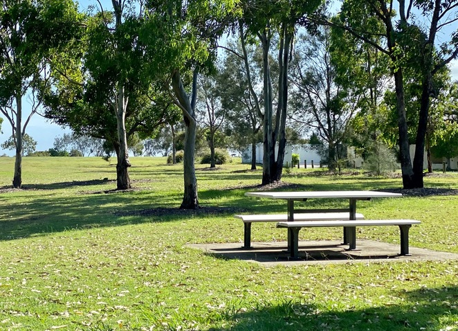The park includes picnic tables overlooking large grassy areas