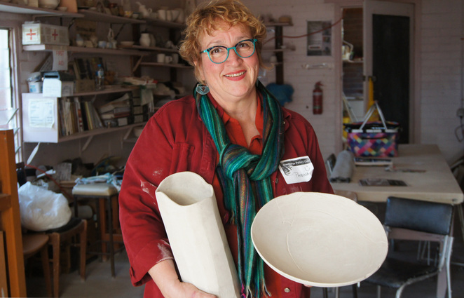 A potter with her works ready to be glazed