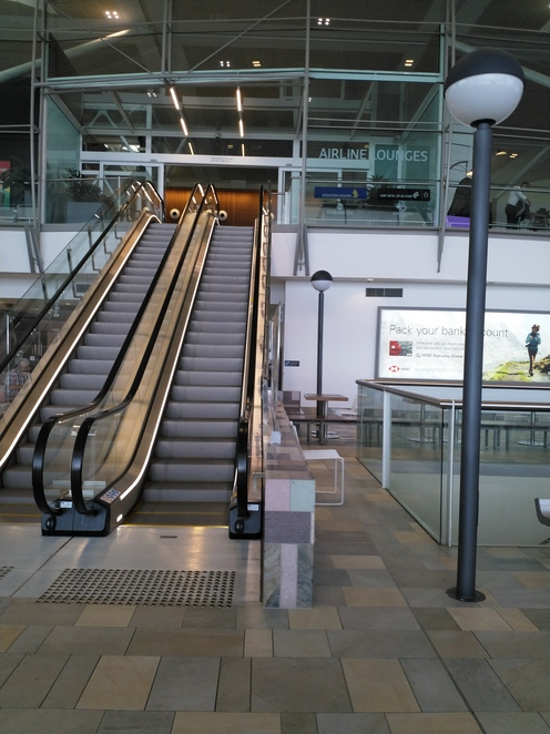 From Level 3, hop on this escalator to access the Plaza Premium Lounge.