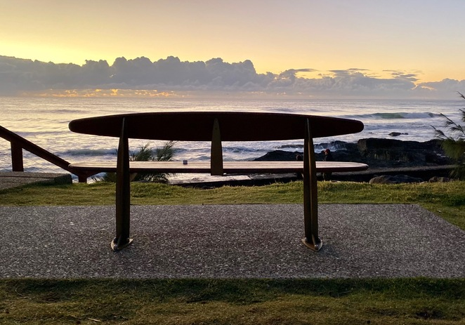 There are iconic Gold Coast surfboard benches and picnic tables overlooking Snapper Rocks