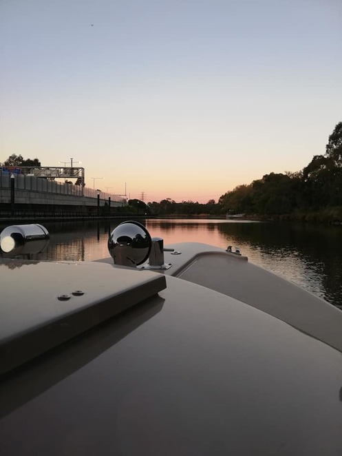 Sunset in Melbourne onboard Yarra River Cruises