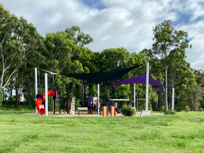 Playground and shaded benches at Freshwater Park in Redland City