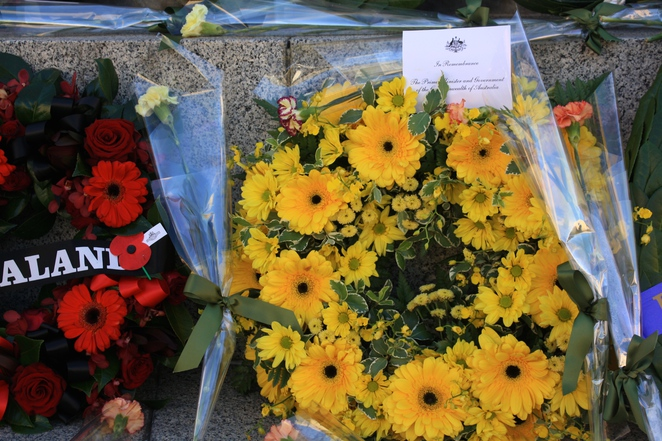 Floral tributes at the National War Memorial on North Terrace