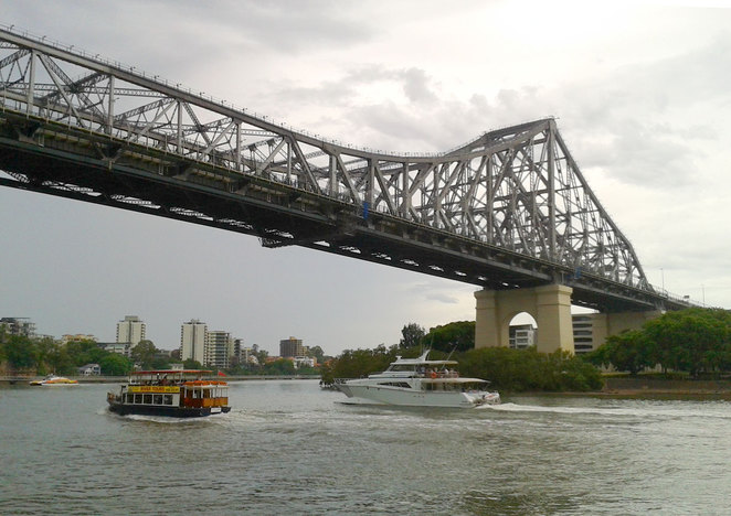 River tour boats passing under the Story Bridge