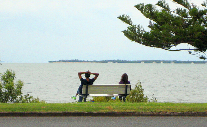 A couple sitting 1.5 metres apart. Are they socially responsible or having an argument?