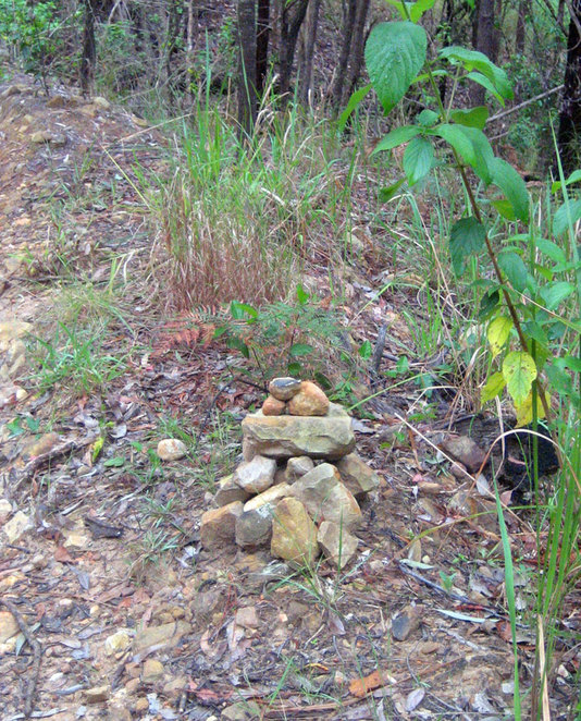 Look for the stone cairns that indicate the start of the hiking trail