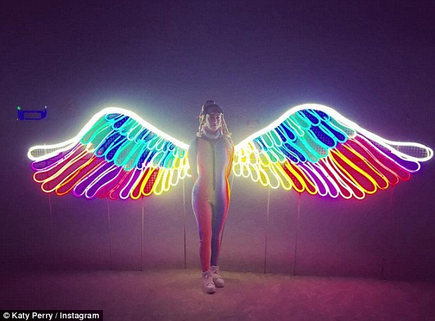 katy perry with neon angel wings