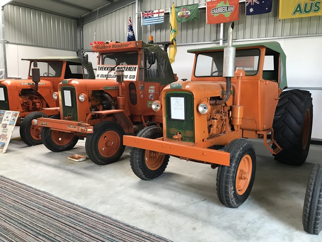 vehicles in the farm shed