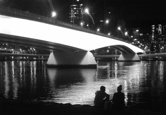 A bottle of wine, a loaf of bread, Brisbane City lights reflected in the river, and thee