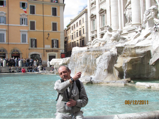 Colin Throws a Coin in the Trevi Fountains