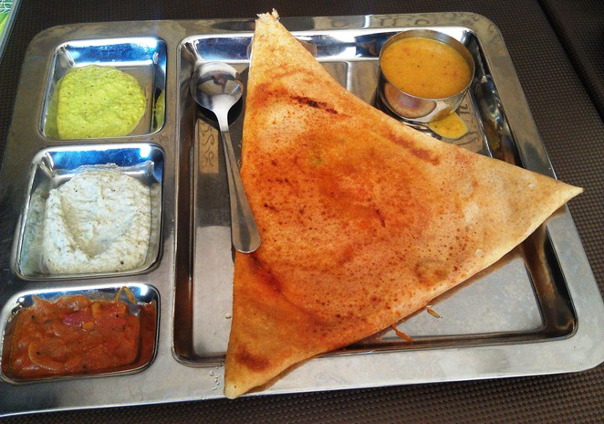 Dosa served with chutneys and sambhar at Saravanaa Bhavan