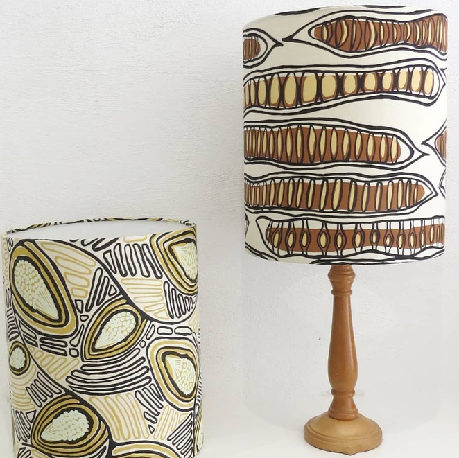 Two new lampshades for Glow made from handprinted fabrics from Nargula Jarndu, Broome. Magabala (Bush banana) designed by Martha Lee on the left and Poinciana Seed Pods by Gabriella Baxter - Image Fabric for Life Facebook Page
