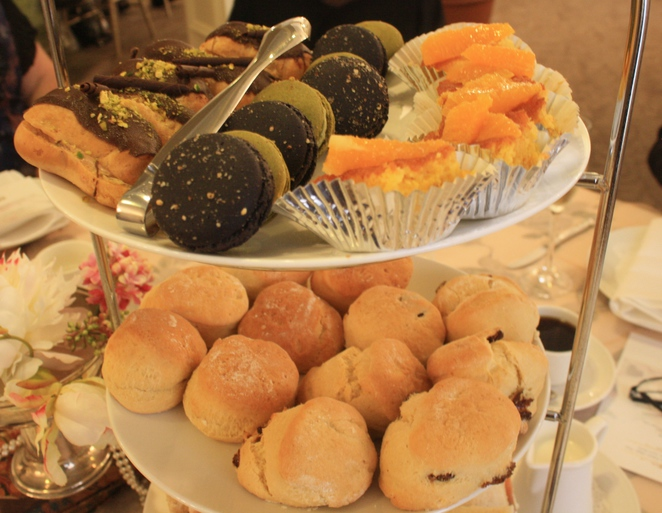 The sweets include mini éclairs with chocolate cream, macaroons and berry pannacotta's.