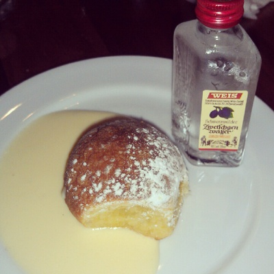 Austrian buchteln filled with plum jam and served with plum schnapps