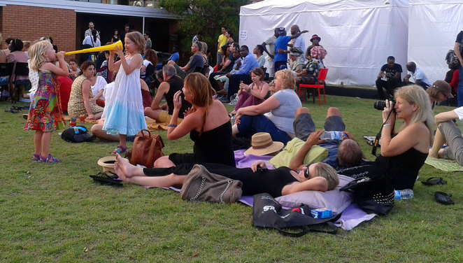 People on the lawns of African House enjoying a concert