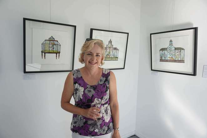 Anna Berger with her artworks