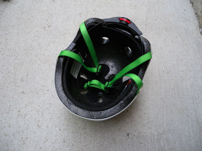 The helmet should fit your head snugly. Turn red wheel at rear of helmet to make bigger or smaller. Tighten or loosen green straps, then fasten under your chin. TIP: Do this before selecting 'Scan to Ride'.