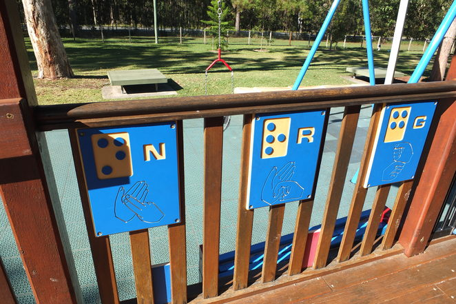 Pioneer Park, All Abilities Playground, Landsborough, Sunshine Coast, multi-sensory, only one on Sunshine Coast, family playground, fully fenced, child-proof gates, flying fox, pioneer cottage, play kitchen, ramp access, climbing structures, braille, hand signage, swings, slides, balancing equipment, bike and walking paths, benches, undercover picnic tables, barbecues, off-street parking, disabled parking, toilet facilities