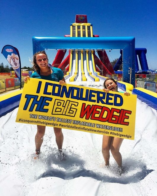 The Big Wedgie, thrill seekers, not for the faint-hearted, tallest and most extreme inflatable waterslide, 18.2 metres, 82 metres long, 55 degree drop, Just Right Wedgie, moderate level, Little Wedgie, minor level, online specials, summer fun