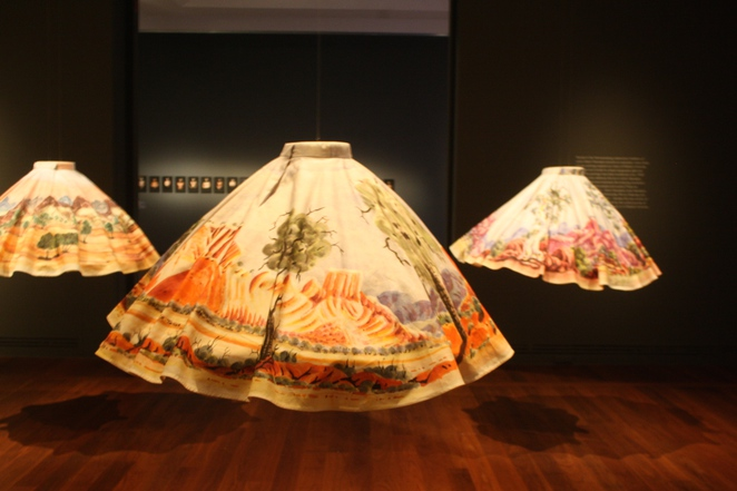 The Namatjira Collection presents skirts and corresponding watercolours painted in the tradition of Albert Namatjira by his descendants.