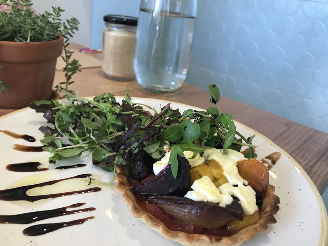 Roasted beetroot, onion and feta tart with petite greens