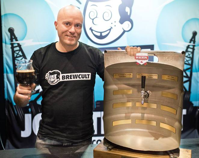 Steve 'Hendo' Henderson from BrewCult with the perpetual trophy for winning the Beer & Brewer People's Choice Best Festival Beer at GABS 2015 for his 'Milk and Two Sugars' sweet stout with coffee