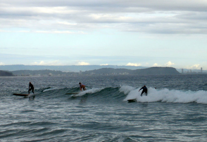Surfers early in the morning at Rainbow Bay