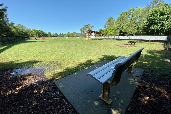 The fenced dog off leash park covers a huge area