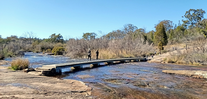 Walking over the Quart Pot Creek in Stanthorpe