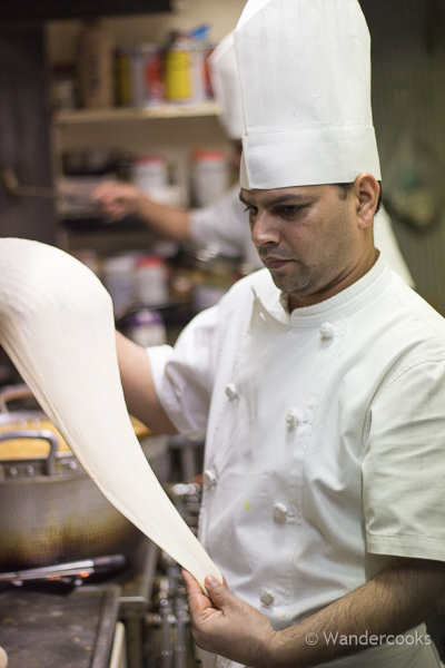 The chef prepares naan at Ruposhi Bangla restaurant in Kogashima, Japan. Curries and lassi also available.