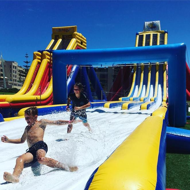 The Big Wedgie, thrill seekers, not for the faint-hearted, tallest and most extreme inflatable waterslide, 18.2 metres, 82 metres long, 55 degree drop, Just Right Wedgie, moderate level, Little Wedgie, minor level, online specials, summer fun, the Big Chucka
