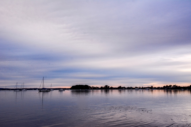 Boats moored off the waterfront at Point Halloran at sunrise