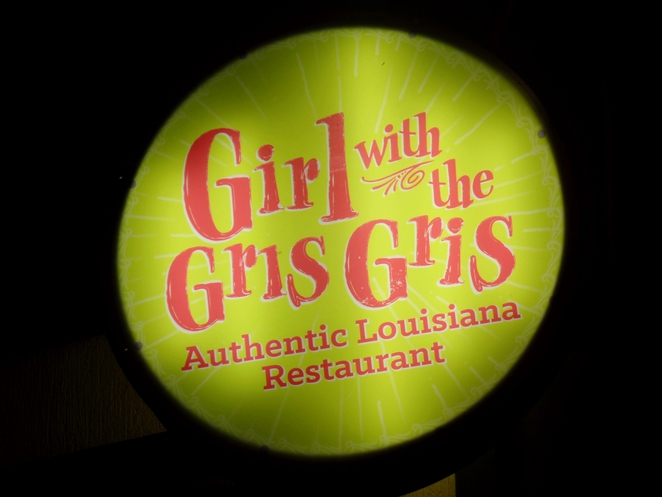 girl with the gris gris logo