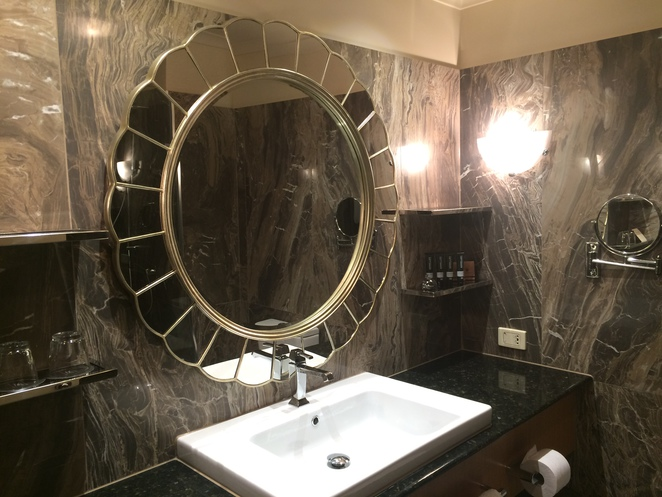 Sparkling, marble bathroom with amenities