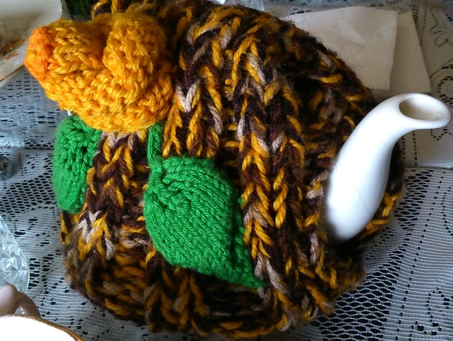Teapot with tea cosy