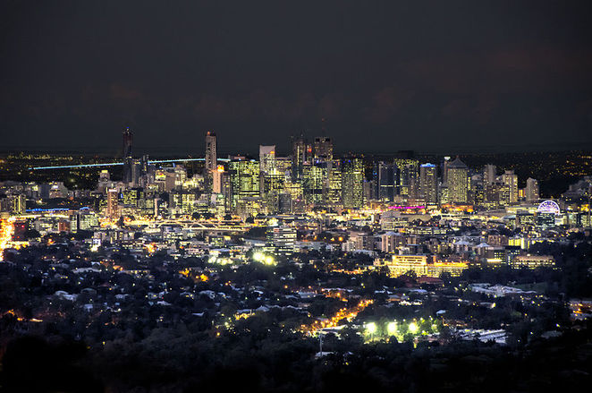 Photo of Brisbane at night courtesy of Wikimedia (Lachlan Fearnley)