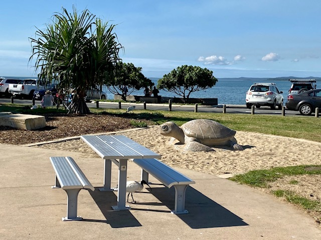 Shaded seating in the Cleveland Lighthouse Reserve adjacent to the Lighthouse restaurant and cafe
