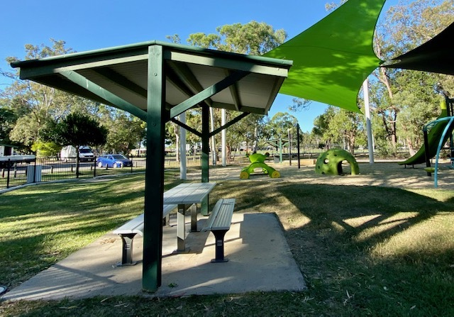 Picnic facilities within the fenced playground area mean parents can relax while their children play