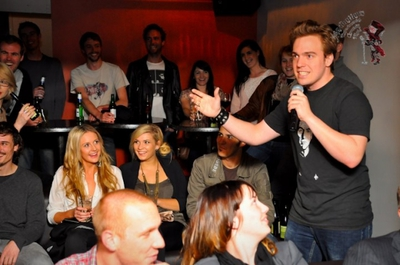 Aussie comedian John Robertson peforming at the Cheeky Sparrow