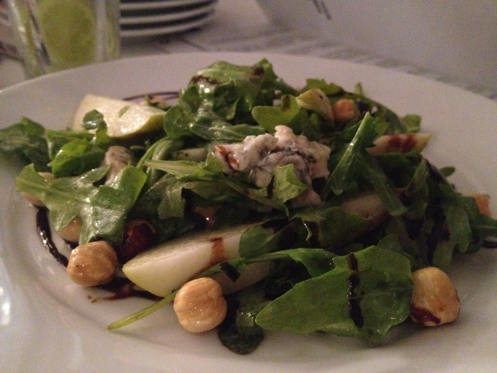 Pear, hazelnut and gorgonzola salad on roquette with apple cider ...